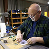 Glass artist Mark Jennings works on putting together the pieces to make a violet suncatcher for the Kokomo Opalescent Gift Shop on Tuesday, February 27. Earlier in February, Jennings fulfilled an order of 100 bunny suncatchers for the White House gift shop.<br /> Kelly Lafferty Gerber | Kokomo Tribune