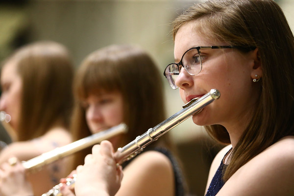Western's Raygan Ballew plays the flute with the festival band as they perform together during the Howard County Music Festival at Eastern High School on Wednesday, March 14, 2018.<br /> Kelly Lafferty Gerber | Kokomo Tribune