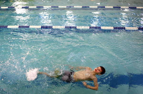 Ryan Hare does the backstroke as he swims laps for the Y-A-Thon on Tuesday evening, March 6. The Y-A-Thon is a week-long event is raising money for the Kokomo YMCA's annual campaign.<br /> Kelly Lafferty Gerber | Kokomo Tribune