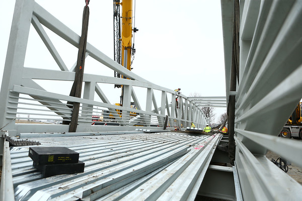 Construction crews continue installing the pedestrian bridge over 931 on Wednesday afternoon, March 28, 2018. The bridge will connect the Nickel Plate trail to downtown Kokomo.<br /> Kelly Lafferty Gerber | Kokomo Tribune