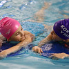 Julia Watson, left, and Thea Key chat as they swim laps in the Kokomo YMCA's pool during the Y-A-Thon on Tuesday, March 6. The Y-A-Thon is a week-long event is raising money for the Kokomo YMCA's annual campaign.<br /> Kelly Lafferty Gerber | Kokomo Tribune