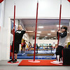 6-year-old Jayce Bryant, left, and 5-year-old Aaron Beaty balance themselves as they move through the swing poles during the Ninja Zone class at Kokomo Flipsters on Tuesday, March 13, 2018.<br /> Kelly Lafferty Gerber   Kokomo Tribune