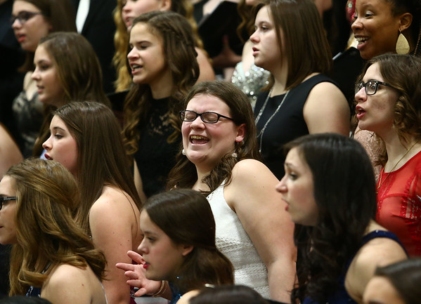 Northwestern's Julia Tharp, center, feels the music as she dances and sings with the festival choir during the Howard County Music Festival at Eastern High School on Wednesday, March 14, 2018.<br /> Kelly Lafferty Gerber | Kokomo Tribune