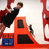 Ethan Pickett, 9, races to the top of the warped wall as Owen Snyder, 6, swings toward the next swiss cheese wall during the Ninja Zone class at Kokomo Flipsters on Tuesday, March 13, 2018.<br /> Kelly Lafferty Gerber | Kokomo Tribune
