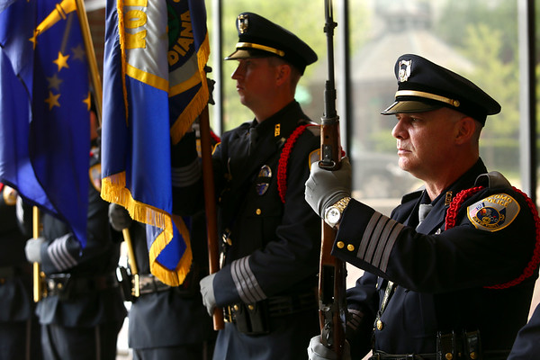 Kokomo Fraternal Order of Police President Jeramie Dodd stands at attention as part of the honor guard during Kokomo Police Department's Fallen Officer Memorial on Thursday, May 17, 2018.<br /> Kelly Lafferty Gerber   Kokomo Tribune