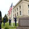 Grissom Air Reserve Base's Honor Guard retires the colors in front the Miami County Courthouse near the WWI memorials. The new Miami County women of WWI memorial marker, left, was unveiled later in the ceremony on Saturday, May 12, 2018.<br /> Kelly Lafferty Gerber | Kokomo Tribune