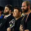"James Robbins, center, holds his decorated ""Victory Road"" graduation cap as he stands for the National Anthem during the Ivy Tech graduation on Friday, May 11, 2018.<br /> Kelly Lafferty Gerber 