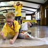 Ashtyn Harts, 8, pops the bubbles on his sheet of bubble wrap at the Camp Angel day camp on Saturday, May 19, 2018. The kids learned that it's okay to be angry, and took out frustrations on bubble wrap. Camp Angel, put on by Guardian Angel Hospice, is for kids who have lost a loved one to learn about the grieving process.<br /> Kelly Lafferty Gerber | Kokomo Tribune