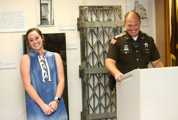 Northwestern senior Megan Osman and Deputy Jake Gibson share a laugh as Gibson talks about Osman before announcing her as the recipient $3,476, one of the Carl Koontz Memorial Scholarships given out on May 30, 2018.<br /> Kelly Lafferty Gerber | Kokomo Tribune