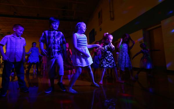 "Kids do the ""Cha Cha Slide"" during the Bon Air Elementary family prom on Friday, May 18, 2018.<br /> Kelly Lafferty Gerber   Kokomo Tribune"