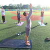 Nancy Salmon, Sarah Pate and Darrell Hollingworth participate in yoga at the stadium lead up by Conner Sanburn on May 23, 2018. <br /> Tim Bath | Kokomo Tribune