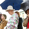 Judy Goodwin, center, dressed in WWI period clothing like a local woman would wear at the time, bows her head during a prayer at the beginning of the ceremony. Miami County honored its women of World War I during a ceremony unveiling a memorial marker in front of the Miami County Courthouse on Saturday, May 12, 2018.<br /> Kelly Lafferty Gerber | Kokomo Tribune