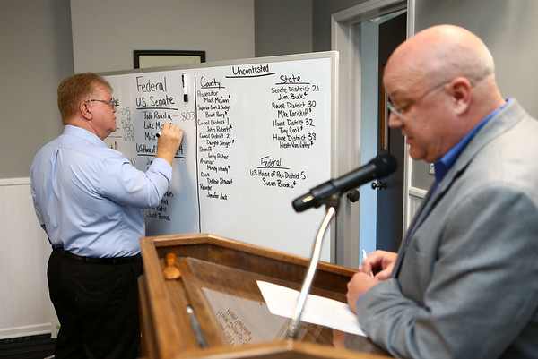 Republican chairman Marty Stout reads the numbers to Jack Dodd who writes them down at the Howard County Republican headquarters on primary election night, May 8, 2018.<br /> Kelly Lafferty Gerber | Kokomo Tribune