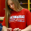 Maconaquah Middle School eighth grader Hannah Montgomery shapes the petals of her poppy as she helps make poppies out of clay on May 2, 2018, for Miami County's World War I memorial.<br /> Kelly Lafferty Gerber | Kokomo Tribune