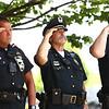 "Jim Calabro, center, salutes as ""Taps"" is played during the Kokomo Police Department's Fallen Officer Memorial on Thursday, May 17, 2018.<br /> Kelly Lafferty Gerber | Kokomo Tribune"