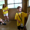 Jacob Glenter, 5, talks about his grandfather after pinning a photo of him on the board. Glenter was part of Guardian Angel Hospice's Camp Angel day camp for kids who've lost a loved one to learn about grieving on Saturday, May 19, 2018.<br /> Kelly Lafferty Gerber | Kokomo Tribune