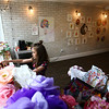 9-year-old Aymara Lind plays with her dolls in the front window of The Studio, surrounded by art by Leah Merrix on Saturday, May 12, 2018.<br /> Kelly Lafferty Gerber | Kokomo Tribune