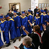 Tri-Central faculty and staff cheer and applaud the 2018 Tri-Central graduates as they line up to start the ceremony on Saturday, May 26.<br /> Kelly Lafferty Gerber | Kokomo Tribune