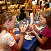 10-year-olds Emma Lees, left, and Joslynne Calloway work together to finish up a painted pottery piece at Fired Arts Studio on May 19, 2018.<br /> Kelly Lafferty Gerber | Kokomo Tribune