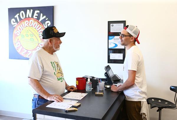Adam Neher, right, takes Jim Roseberry's order at Stoney's Sourdough Pizza on May 10, 2018.<br /> Kelly Lafferty Gerber | Kokomo Tribune