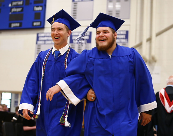 Zachary Juday, left, and Noah Lucas link arms as they enter the gym at the start of Tipton High School's 2018 graduation on Saturday, May 26.<br /> Kelly Lafferty Gerber | Kokomo Tribune