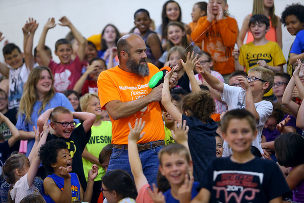 Maconaquah Elementary students gathered to watch their principal Kelly McPike and the middle school principal Craig Jernagan kiss a pig on May 30, 2018. The event was a fundraiser that brought in $1100 to help a family who's father is in the hospital with a brain tumor.<br /> Tim Bath   Kokomo Tribune