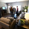 Attendees of the open house take a look inside the living room at Bona Vista's Meridian Park Apartments on Tuesday, May 1, 2018.<br /> Kelly Lafferty Gerber | Kokomo Tribune