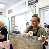 Gina Kersey works on staining her wooden sign at Stain on Main on Saturday, May 12, 2018.<br /> Kelly Lafferty Gerber | Kokomo Tribune