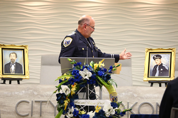Captain Kevin Summers gestures to the photo of Al Berryman, who was killed in the line of duty on November 26, 1953, as the Kokomo Police Department honors Berryman and Thomas Lannon, who was killed on August 22, 1877.<br /> Kelly Lafferty Gerber   Kokomo Tribune