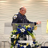 Captain Kevin Summers gestures to the photo of Al Berryman, who was killed in the line of duty on November 26, 1953, as the Kokomo Police Department honors Berryman and Thomas Lannon, who was killed on August 22, 1877.<br /> Kelly Lafferty Gerber | Kokomo Tribune
