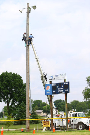 Duke Energy lineman replace a light pole at Huston Park as part of a service day where they give back to the community on May 22, 2018.