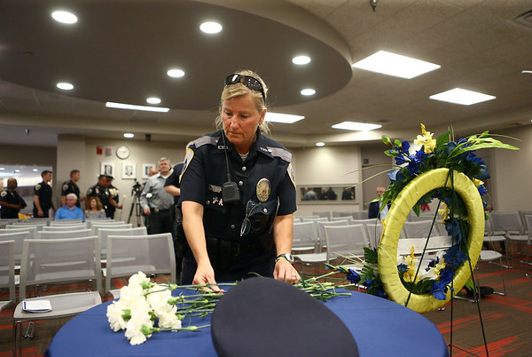 Beth Gunlite lays a carnation down in memory of Kokomo Police Department's fallen officers on Thursday, May 17, 2018.<br /> Kelly Lafferty Gerber | Kokomo Tribune