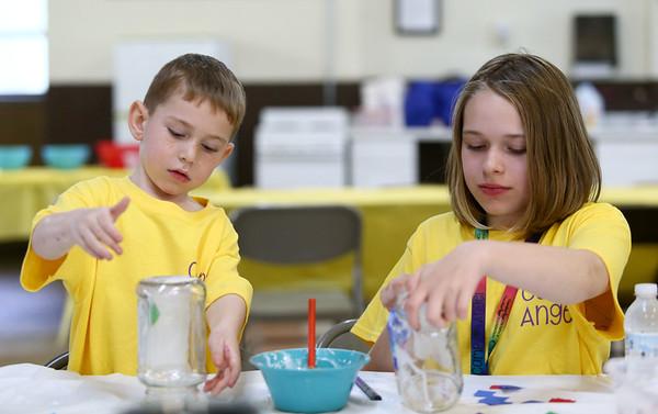 5-year-old Jacob Glenter, and his sister 10-year-old Jenna Glenter, make memory lanterns during the Camp Angel day camp on Saturday, May 19, 2018.<br /> Kelly Lafferty Gerber | Kokomo Tribune