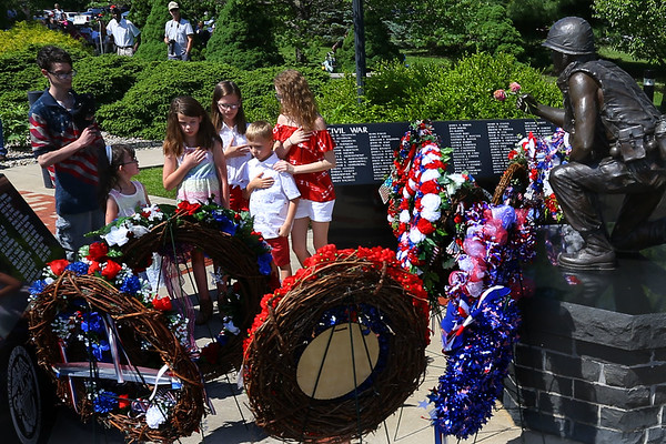 Memorial Day ceremony held at the Veterans Memorial at Darrough Chapel Park on Monday May 28, 2018. Daughters and sons of the Daughters of the American Revolution place a wreath at the memorial.<br /> Tim Bath | Kokomo Tribune