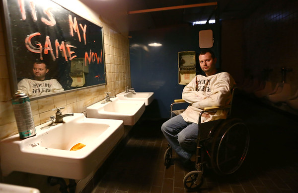 Justin Eikenberry is the mastermind behind Streaper's Escape Adventures in Peru, Indiana. He came up with the puzzles, storyline, and the sets, like this one, Grimhurst Asylum, which takes places in a bathroom.<br /> Kelly Lafferty Gerber | Kokomo Tribune