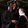 Lola Washington smiles as she crosses the stage to cheers and noisemakers from people in the audience during the Ivy Tech graduation on Friday, May 11, 2018.<br /> Kelly Lafferty Gerber | Kokomo Tribune
