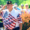 Memorial Day ceremony held at the Veterans Memorial at Darrough Chapel Park on Monday May 28, 2018. Dave Migrant salutes the flag while the Men of Note sing the National Anthem.<br /> Tim Bath | Kokomo Tribune