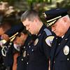 Police Chief Rob Baker bows his head during a prayer at the Kokomo Police Department's Fallen Officer Memorial on Thursday, May 17, 2018.<br /> Kelly Lafferty Gerber | Kokomo Tribune