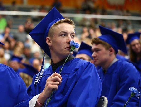 Andrew Corner puts his flower up to his nose during Tipton High School's 2018 graduation on Saturday, May 26.<br /> Kelly Lafferty Gerber | Kokomo Tribune
