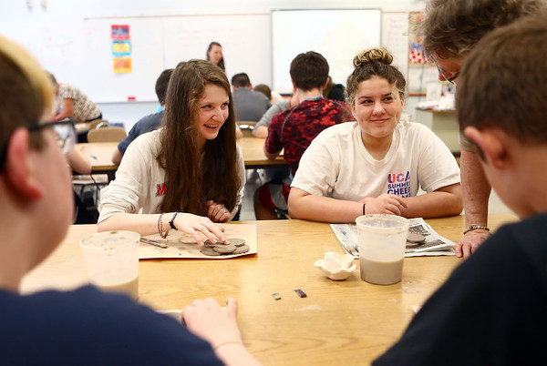 Maconaquah Middle School eighth graders Grace Lewis, left, and Allie Wilson make poppies out of clay in their art class on May 2, 2018, for Miami County's World War I memorial.<br /> Kelly Lafferty Gerber   Kokomo Tribune