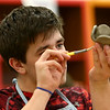 Kaile Sharp carefully shapes his poppy as he, along with his Maconaquah Middle School classmates, made poppies out of clay in their art class on May 2, 2018, for Miami County's World War I memorial.<br /> Kelly Lafferty Gerber | Kokomo Tribune