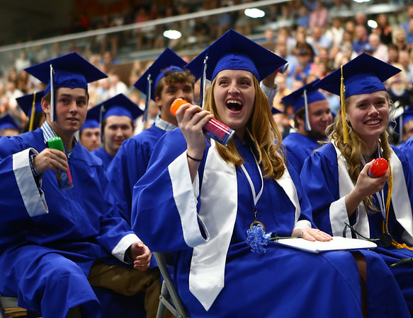 Morgan Henderson shakes her silly string can in preparation for the onslaught of silly string at the end of Tipton High School's 2018 graduation on Saturday, May 26.<br /> Kelly Lafferty Gerber | Kokomo Tribune