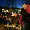 """Dustin Chase kisses his 2-year-old daughter Kaelyn Chase on the cheek as they wait in line to check out decorations at """"A Seiberling Snowman Spectacular"""" during the lighting ceremony on Saturday, November 24, 2018. <br /> Kelly Lafferty Gerber 