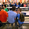 Baker Woolley, right, whispers to his friend Ben Lemons during seventh grade lunch at Western Middle School on October 11. Because Baker has mitochondrial disease, his body doesn't process nutrients from food well. It requires too much energy. Baker gets the nutrients he needs from his feeding tube.<br /> Kelly Lafferty Gerber | Kokomo Tribune