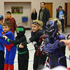 Skylar Grimes, 10, a Webelo in Kokomo's Cub Scout Pack 3506 and dressed as cat woman, recites the Scout Law with the rest of her pack during closing of the Halloween-themed meeting in October.<br /> Kelly Lafferty Gerber | Kokomo Tribune