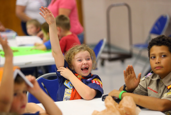 6-year-old Eden Hoppes, a Tiger in Cub Scout Pack 3506, raises her hand to answer a question during a meeting in September. Hoppes has been going to Cub Scout meetings with her older brother since she's been in diapers and last May, she was able to officially become a Cub Scout.<br /> Kelly Lafferty Gerber | Kokomo Tribune