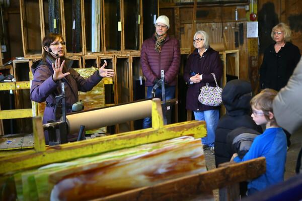 Laura Noel, explains the history of Kokomo Opalescent Glass to a tour group on Friday, November 23, 2018.<br /> Kelly Lafferty Gerber | Kokomo Tribune