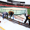 Jim Dixon, Russell Davis and Wayne Seybold with Ice Games 88 set up the ice skating rink at Kokomo Municipal Stadium on Nov. 26, 2018. Skating will be available starting Dec 5 for $10 a person on the 60 by 90-foot rink. Water will be sprayed on tubing under the ice that are cooled by 4 chillers in layers till its 2 to 3 inches thick starting later this week.<br /> Tim Bath | Kokomo Tribune