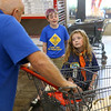6-year-old Eden Hoppes sells popcorn for Cub Scout Pack 3506 at Rural King in September. Hoppes was one of the first girls in Howard County to join Cub Scouts.<br /> Kelly Lafferty Gerber | Kokomo Tribune