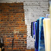 Part of the brick wall with the oldest signatures of workers from the late 1800s and early 1900s at Kokomo Opalescent Glass on Friday, November 23, 2018.<br /> Kelly Lafferty Gerber | Kokomo Tribune